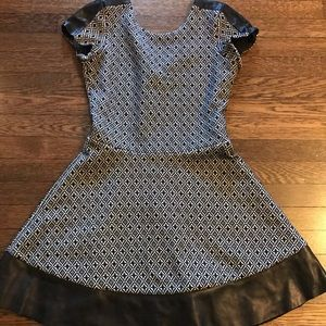 Woman's mini dress with leather trim